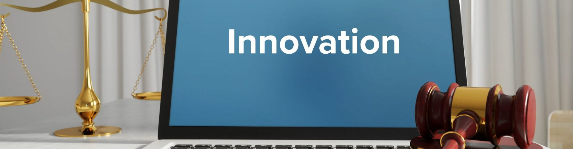 Innovation – Law, Judgment, Web. Laptop in the office with term on the screen. Hammer, Libra, Lawyer.